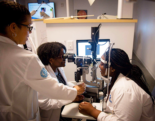 3 students practicing an optometry exam