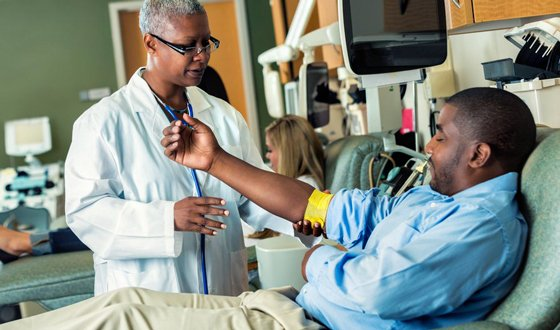 redbox-community-benefit_image_doctor_helping_clinic_560x330.jpg