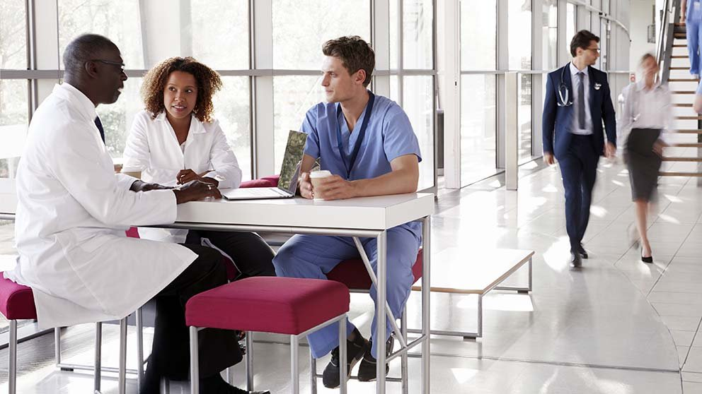 Doctors and medical personnel sitting at table