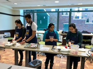 culinary medicine students chopping food